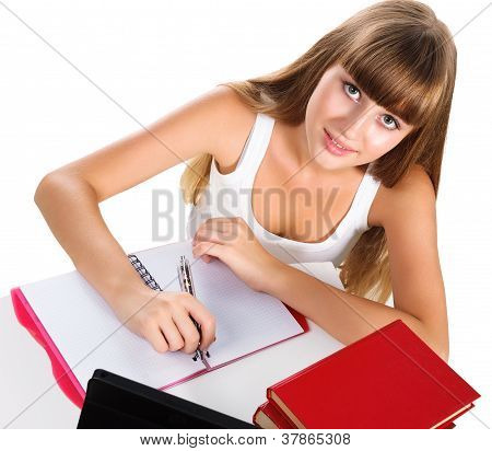 Cute Teen Girl Homeschooling With Books And Tablet Isolated Over White