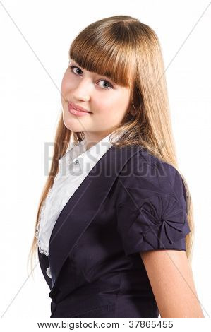 Portrait Of Cute Teen Girl Wearing Formal Uniform Over White