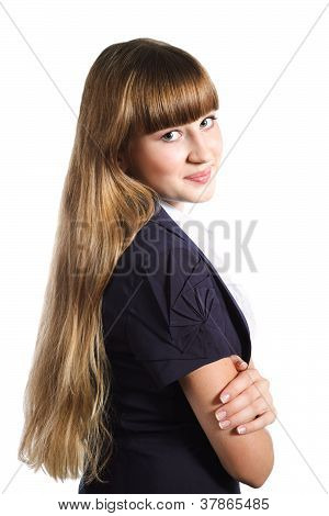 Portrait Of Cute Teen Girl Wearing Formal School Uniform Over White Background