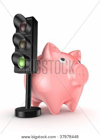 Traffic light and pink piggy bank.