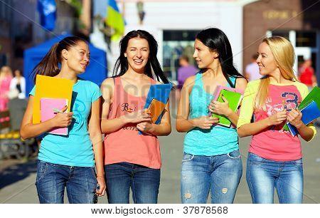 Four Beautiful College Girls Walking On The Street