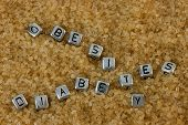 stock photo of diabetes symptoms  - Letter tiles spelling out the words Obesity and Diabetes on a background of brown sugar - JPG