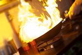 picture of liver fry  - Chef is making flambe with pan and fire - JPG