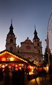 stock photo of weihnacht  - German christmas market with church and lots of little lights - JPG