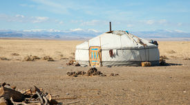 stock photo of safe haven  - traditional dwelling of Mongolian nomadic yurt a safe haven in a harsh climate - JPG
