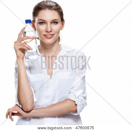 contented european brunette woman & a bottle of clear water - isolated on white background
