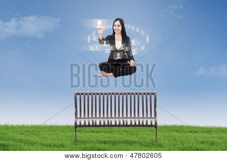 Businesswoman Touching Interface Icon