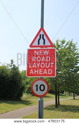 Road narrows and new road layout signs