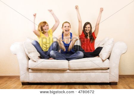 Three Women Are Cheering On A Lounge