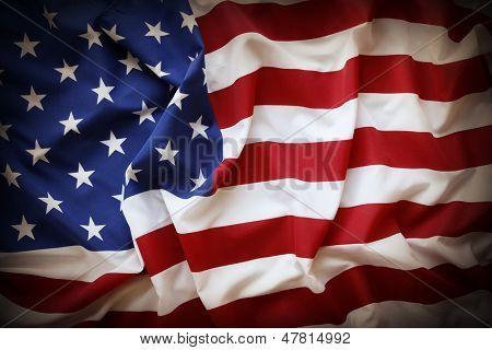 Closeup of ruffled American flag. Dark edges