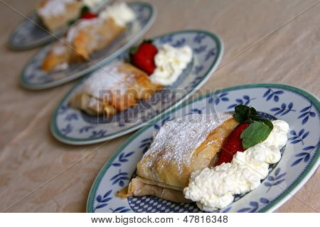 Dishes of Fresh Apple strudel (Apfelstrudel) - Popular traditional Viennese pastry