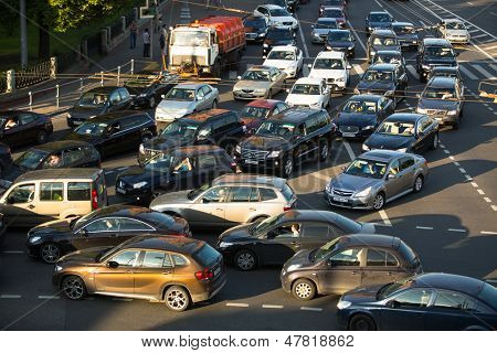 MOSCOW - JUNE 13: Cars stands in traffic jam on the city center, June 13, 2013, Moscow Russia. Moscow Mayor Sobyanin reconstructs suburban railways, to solve problem of traffic jams in 2016.