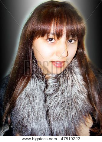 Beautiful girl and fur coat