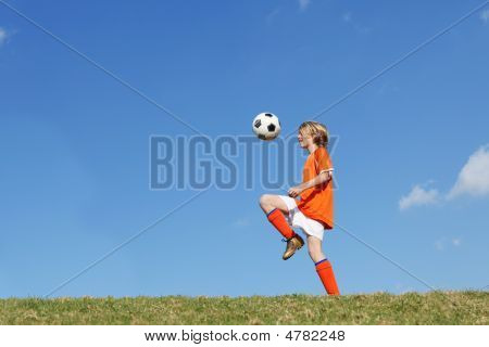 Child Or Boy Playing Soccer Or Football