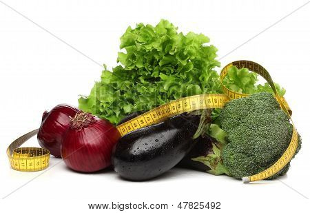 Delicious group of vegetables and a measurent tape