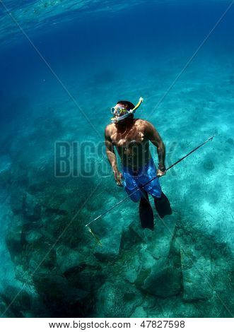 Man Spearfishing Underwater