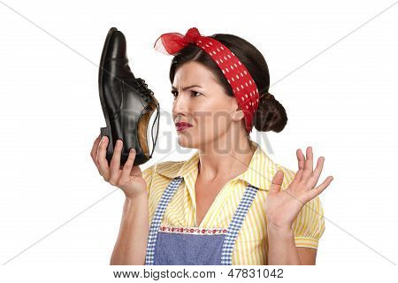 Beautiful Vintage Housekeeper Holding  A Smelly Shoes With Facial Expression