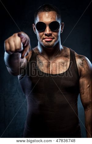 Muscular Handsome Young Man In Sunglasses Pointing On You
