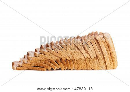 brown sliced wholemeal loaf of bread on white background