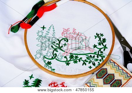 Embroidery on white tablecloth.