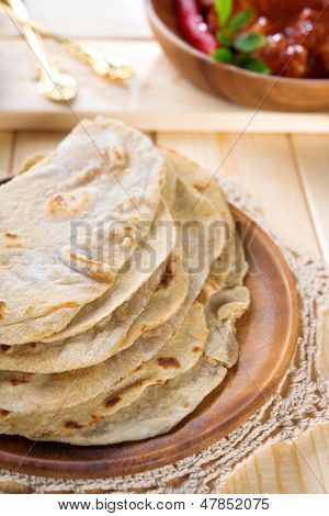 Chapati or chapatti, Indian chicken curry, popular Indian food.