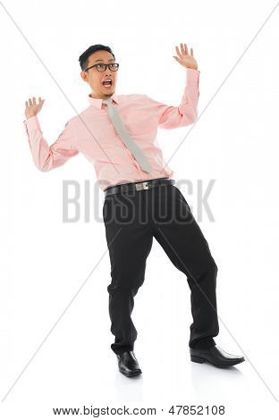 Full body shocked young Asian businessman open arms body bend backwards, isolated on white background