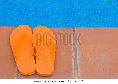 flip flops on pool side