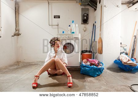 young woman in laundry, she waits