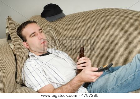Male With Beer Watching Tv