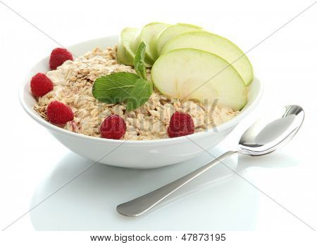 tasty oatmeal with raspberries and apple, isolated on white
