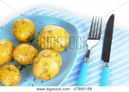 Boiled potatoes on platen on napkin isolated on white