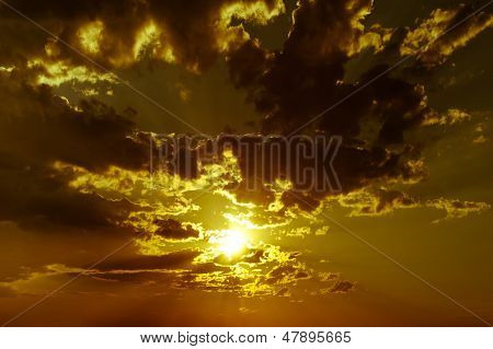 Dramatic background with cloudy sky at sunset