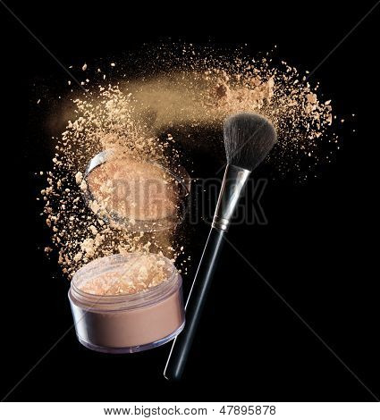 Isolated make-up powder with brush on black background