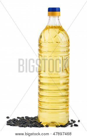 Bottle of sunflower oil and seeds near