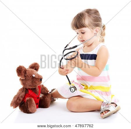 Little cute girl playing doctor, isolated on white