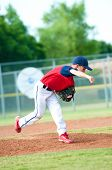stock photo of little-league  - Little league baseball boy pitching during a game - JPG