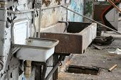 two sinks in a disused factory