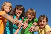 stock photo of tween  - group ofpositive happy smiling tweens kids or children with thumbs up - JPG