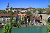image of beside  - Cityscape of Bern Switzerland with arch bridge and old historic houses beside the Aare River - JPG