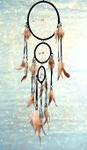 stock photo of dream-catcher  - Beautiful dream catcher on blue background with lights - JPG