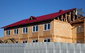 picture of rafters  - Second floor and roof of a new house during construction - JPG