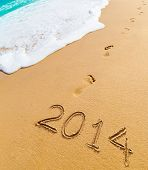 image of footprints sand  - 2014 and footprints on sand beach - JPG