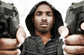 stock photo of handguns  - Angry Young Black Adult Male with Handguns - JPG