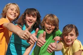 pic of tween  - group ofpositive happy smiling tweens kids or children with thumbs up - JPG