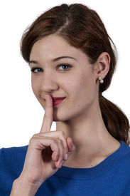 stock photo of shhh  - A woman saying be quiet by saying shhh - JPG