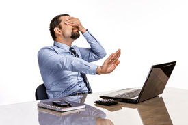 stock photo of pornography  - frustrated businessman close his eyes by hand - JPG