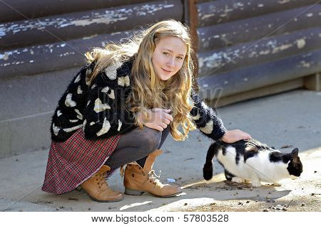 Girl And Barn Cat