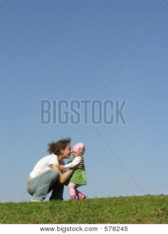 Mother With Baby On Meadow