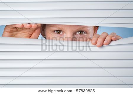No Privacy - Woman Peeking Through Blinds