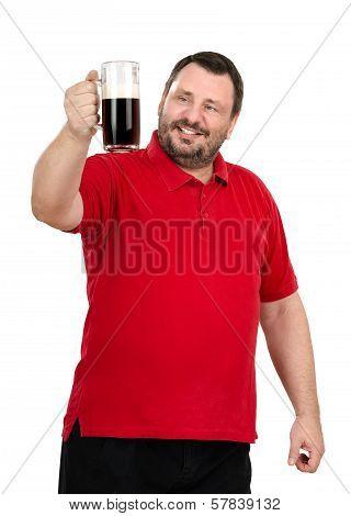 Bearded Man Stares At A Dark Beer Mug